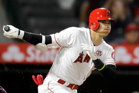 Los Angeles Angels' Shohei Ohtani, of Japan, watches a foul ball during the third inning of a b ...