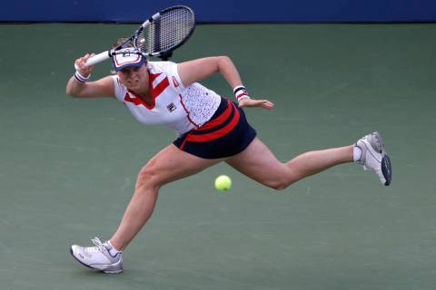 FILE - In this Aug. 29, 2012, file photo, Kim Clijsters returns a shot to Laura Robson in the s ...