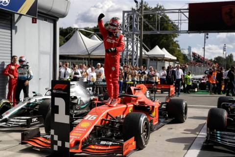 Ferrari driver Charles Leclerc of Monaco celebrates after winning the Formula One Italy Grand P ...
