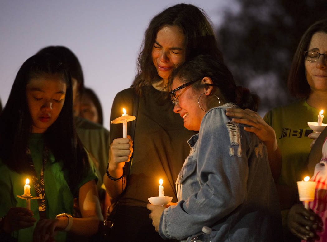 Dyana Melchor, right, is comforted by a friend at Desert Horizons Park during a vigil for Paula ...