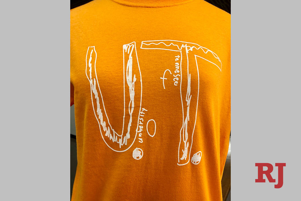This photo shows a University of Tennessee shirt using the design of a fourth-grader who was bu ...