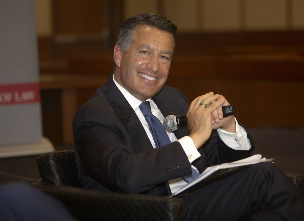 Former Nevada Gov. Brian Sandoval smiles during the Nevada Senators Panel at UNLV, Thursday, Se ...