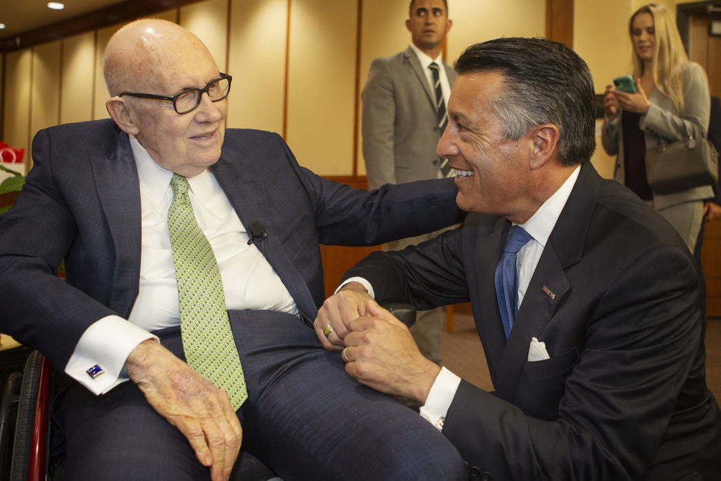 Former U.S. Sen. Harry Reid, left, talks with former Nevada Gov. Brian Sandoval before the Neva ...