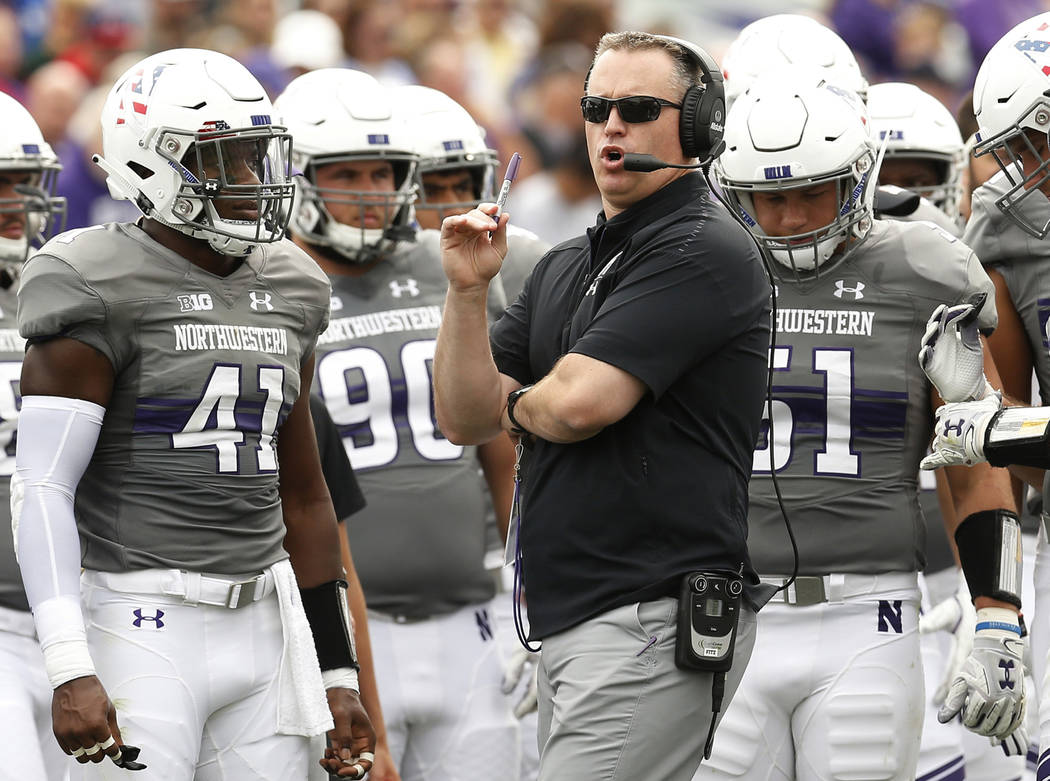FILE - In this Saturday, Sept. 8, 2018, file photo, Northwestern coach Pat Fitzgerald speaks wi ...