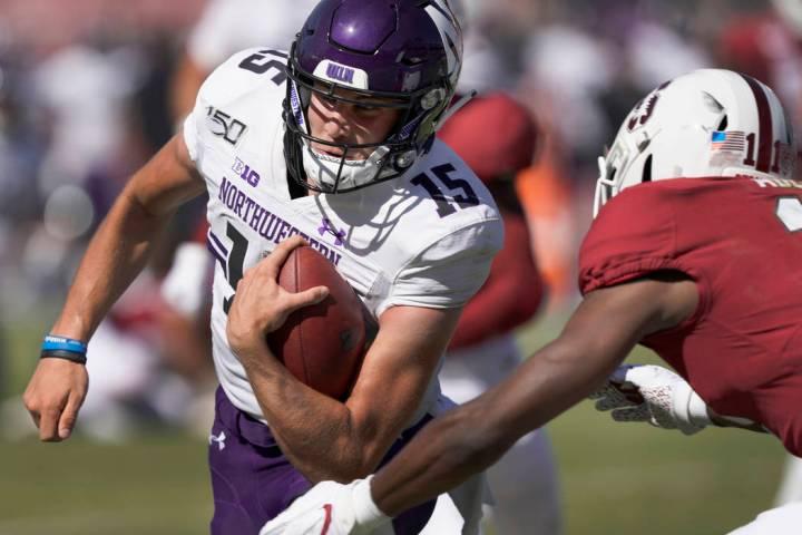 Northwestern quarterback Hunter Johnson (15) scrabbles past Stanford cornerback Paulson Adebo ( ...