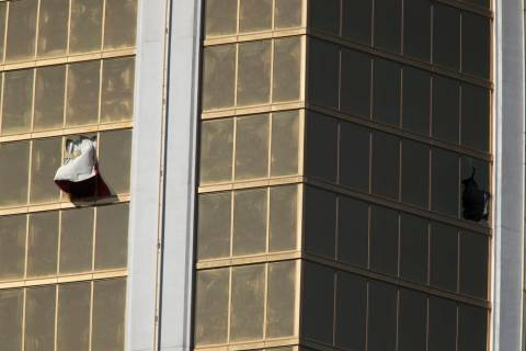 Broken windows at Mandalay Bay in Las Vegas on Oct. 2, 2017, after a shooting left 58 people de ...