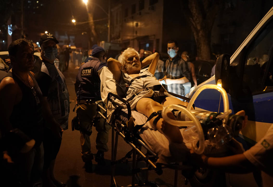 Patients are evacuated from a burning hospital in Rio de Janeiro, Brazil, Thursday, Sept. 12, 2 ...