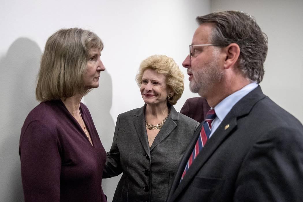 Sen. Gary Peters., right, Sen. Debbie Stabenow, D-Mich., center, and Elizabeth Whelan, the sist ...