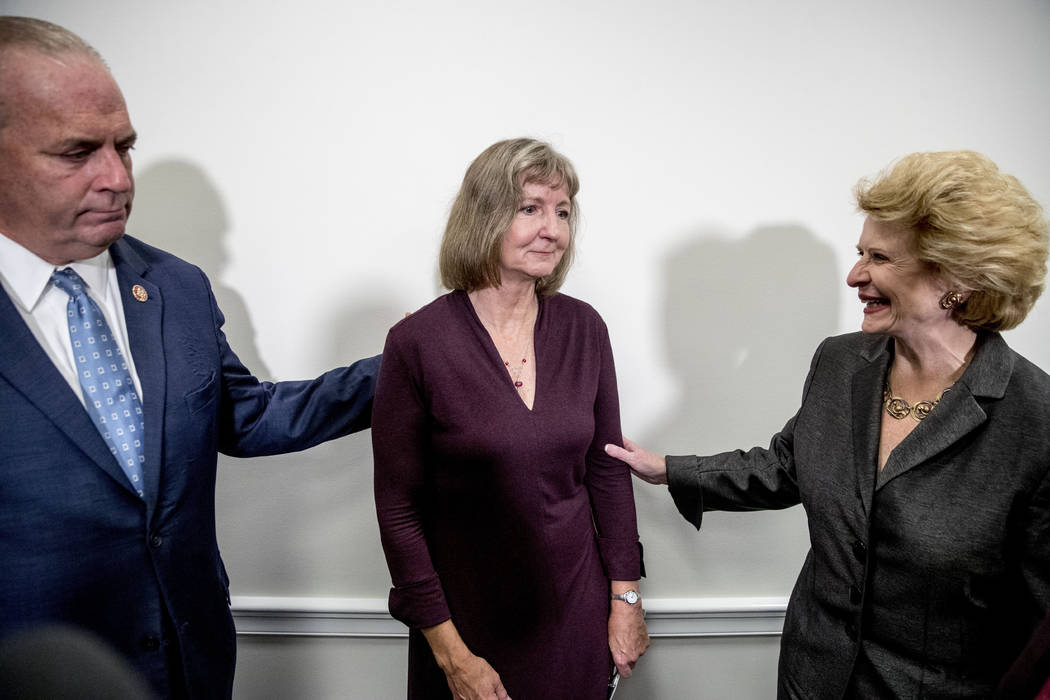 Rep. Dan Kildee, D-Mich., left, Sen. Debbie Stabenow, D-Mich., right, and Elizabeth Whelan, the ...