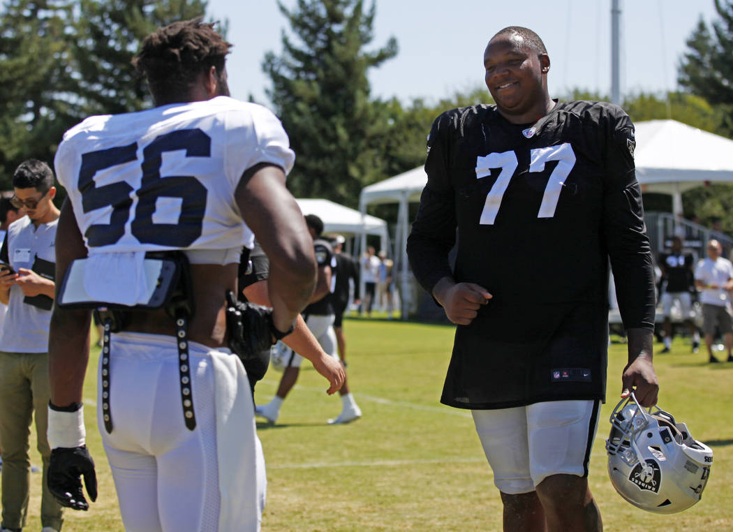 Oakland Raiders offensive tackle Trent Brown (77) meets with Los Angeles Rams defensive end Dan ...