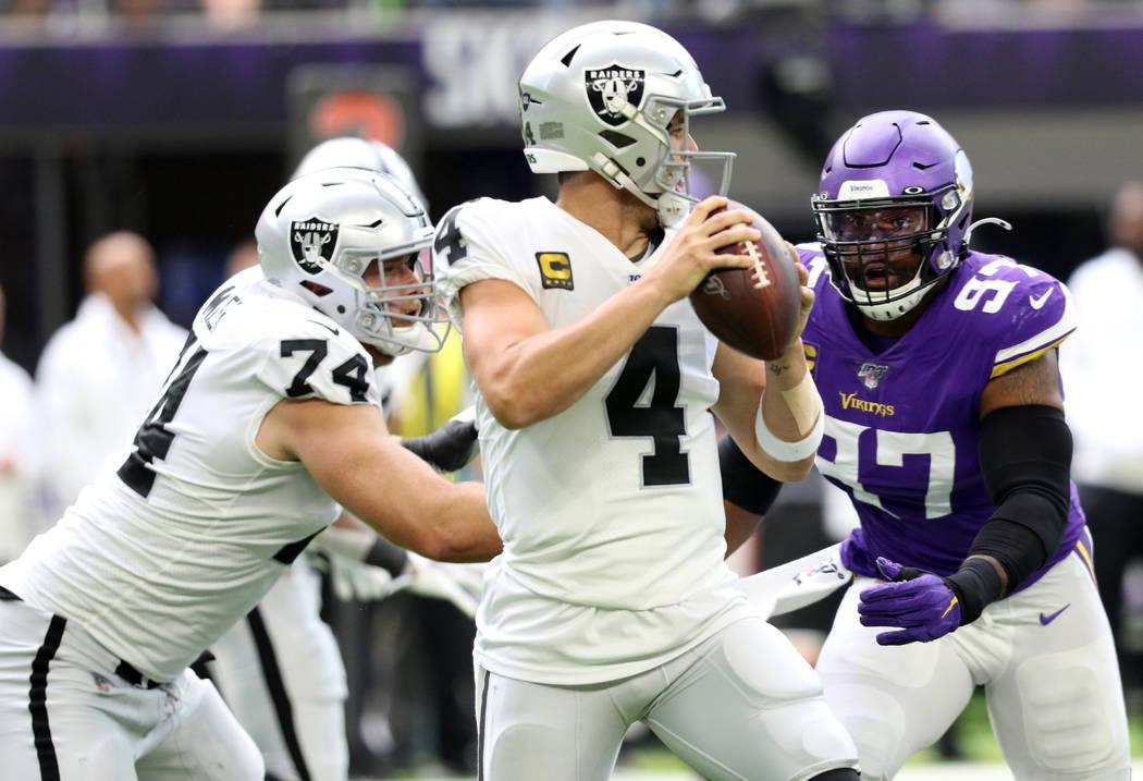 Oakland Raiders offensive tackle Kolton Miller (74) misses his block on Minnesota Vikings defen ...