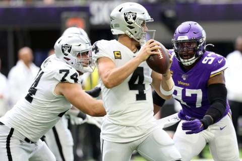 Oakland Raiders offensive tackle Kolton Miller (74) misses his block on Minnesota Vikings defen ...