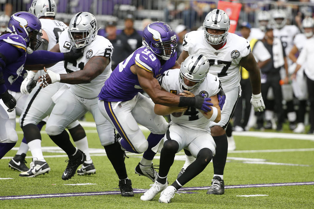 Minnesota Vikings defensive end Danielle Hunter (99) sacks Oakland Raiders quarterback Derek Ca ...