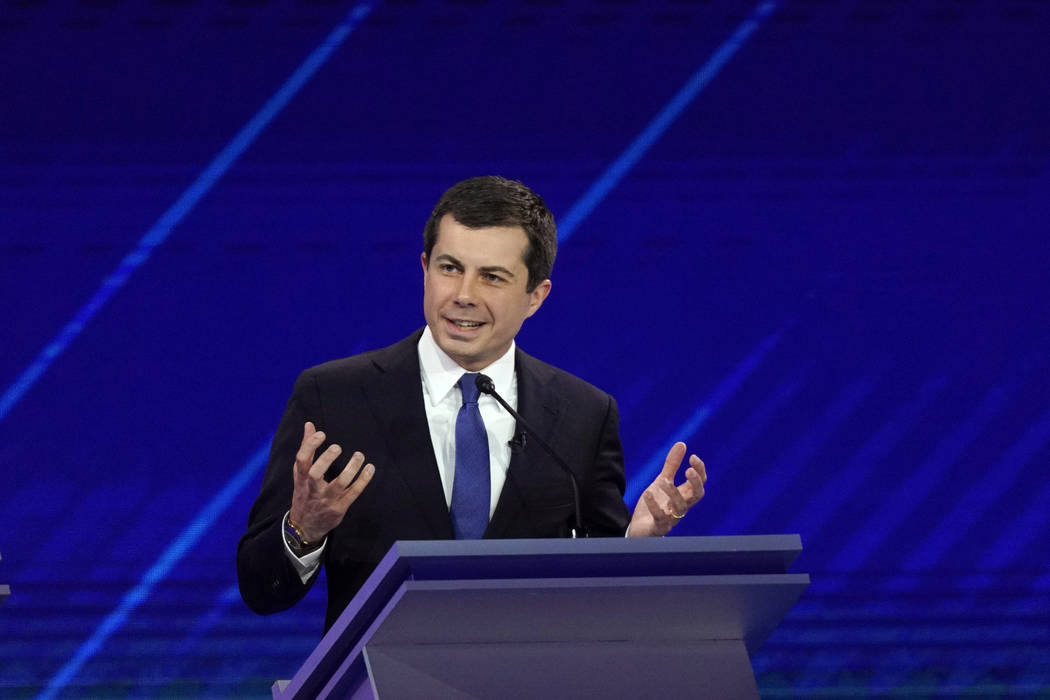 Democratic presidential candidate South Bend Mayor Pete Buttigieg answers a question Thursday, ...