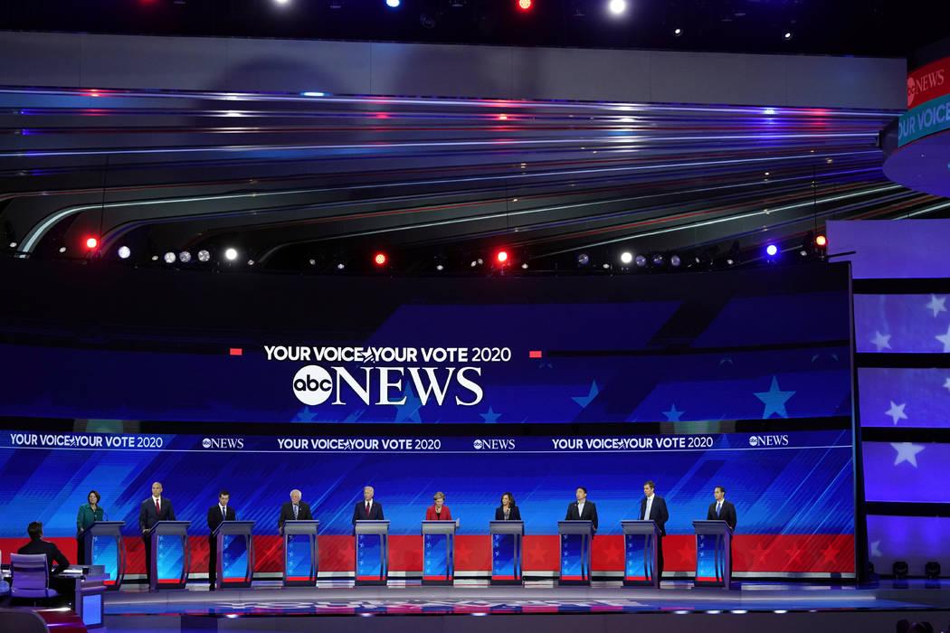 From left, Democratic presidential candidates Sen. Amy Klobuchar, D-Minn., Sen. Cory Booker, D- ...