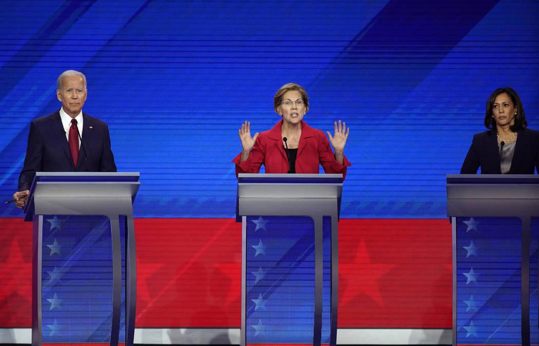 Former Vice President Joe Biden, left, and Sen. Kamala Harris, D-Calif., right, listen as Sen. ...