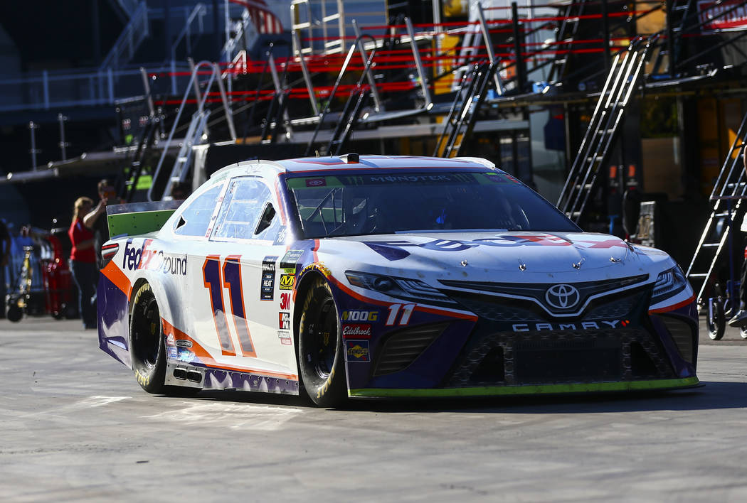 Denny Hamlin (11) heads to the track during qualifying for the Monster Energy NASCAR Cup Series ...