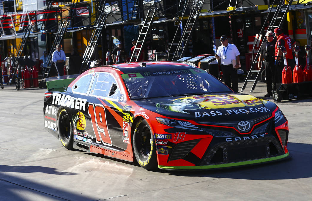 Martin Truex Jr. (19) heads to the track during qualifying for the Monster Energy NASCAR Cup Se ...
