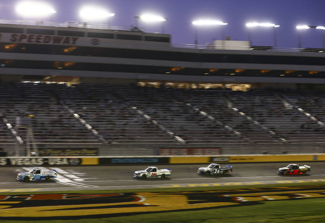 Drivers during a caution while competing in the NASCAR World of Westgate 200 Truck Series auto ...