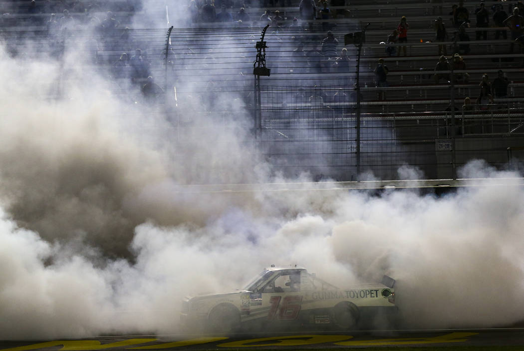 Austin Hill celebrates his win with a burnout at the NASCAR World of Westgate 200 Truck Series ...