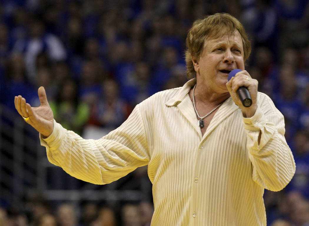 Eddie Money sings the national anthem before an NCAA college basketball game between Kansas and ...