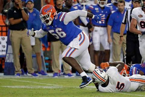 Florida defensive lineman Tedarrell Slaton celebrates after making a tackle on UT Martin runnin ...
