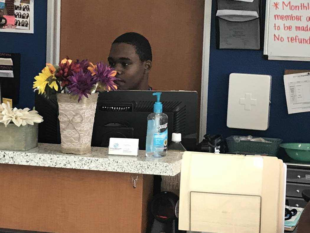 Valley High School sophomore Tyrese Jackson, 15, helps at the front desk Sept. 12 at the Ralph ...