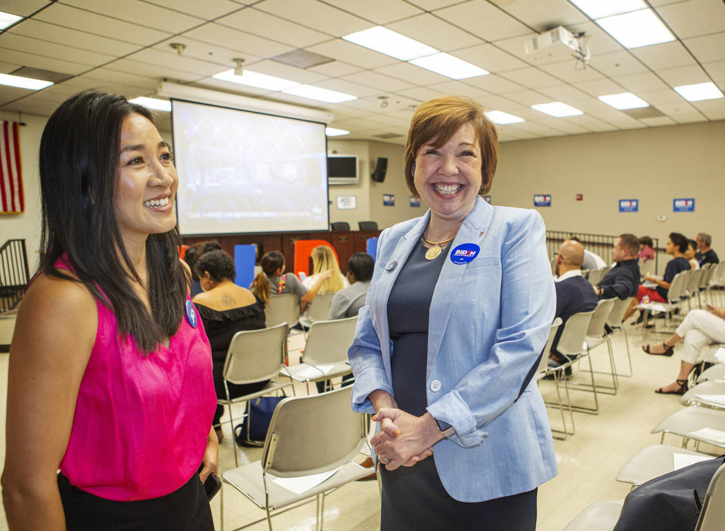 Michelle Kwan, two-time Olympic figure skating medalist, left, talks with Nevada Assemblywoman ...