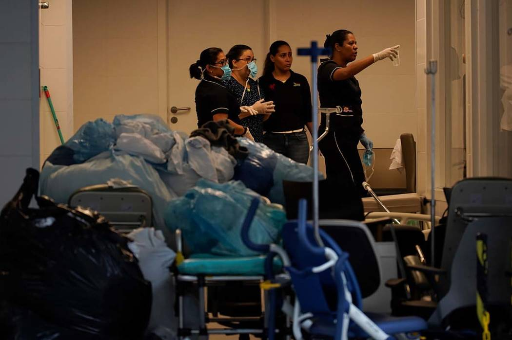 Hospital employees work next to medical equipments at the Badim Hospital, where a fire left at ...