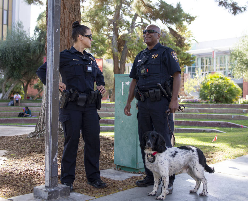 University Police Services officer Bree Torrey, left, and officer Darrell Johnson with K9 Buste ...