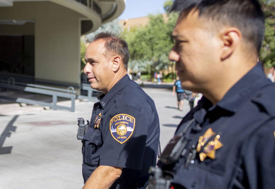 University Police Services officer Joe Alliyani, left, and officer Kawika Antolin, on duty at U ...