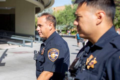 University Police Services officer Joe Alliyani, left, and officer Kawika Antolin, on duty at U ...