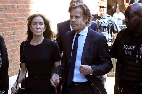 Felicity Huffman arrives at federal court with her husband William H. Macy for sentencing in a ...
