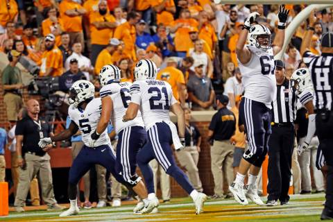 Brigham Young running back Ty'Son Williams (5) celebrates the game-winning touchdown with teamm ...