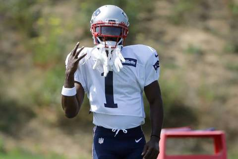 New England Patriots wide receiver Antonio Brown works out during an NFL football practice, Wed ...