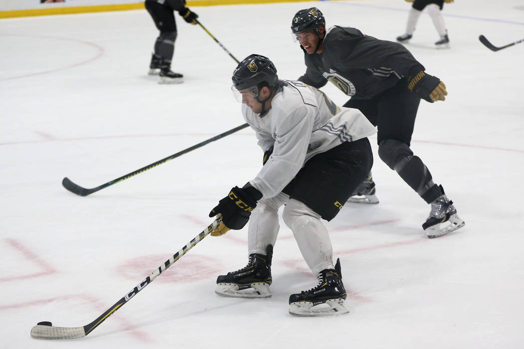 Vegas Golden Knights center Paul Cotter (43) moves with the puck as defenseman Brayden McNabb ( ...
