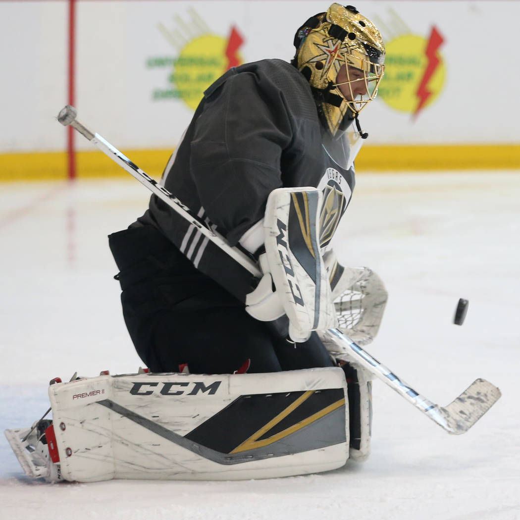 Vegas Golden Knights goaltender Marc-Andre Fleury (29) blocks a shot during a team practice at ...