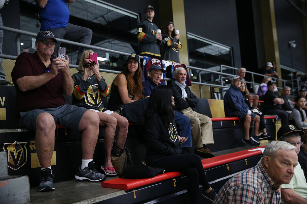 Fans watch the Vegas Golden Knights practice at City National Arena in Las Vegas, Friday, Sept. ...