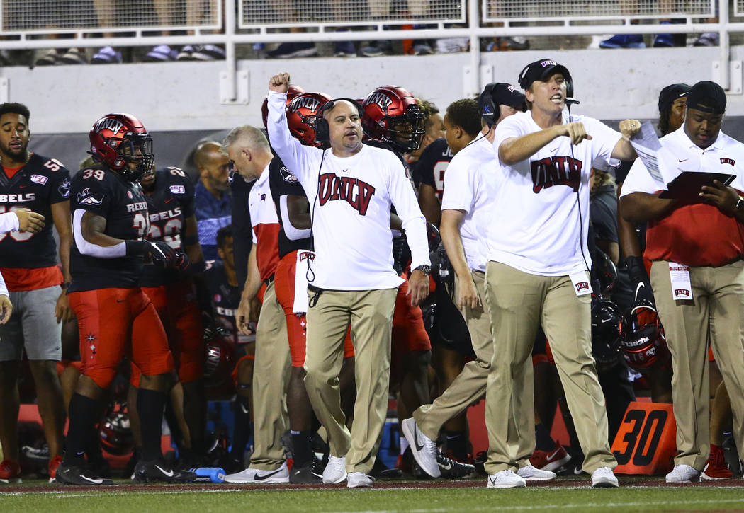 UNLV Rebels head coach Tony Sanchez motions to his team during the second half of an NCAA foot ...