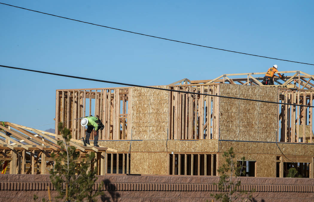 Construction under KB Home continues at the Desert Mesa neighborhood in North Las Vegas, Monday ...