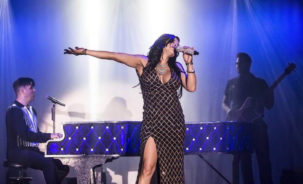 Singer Nieve Malandra, middle, performs with piano showman Frankie Moreno, left, at The Showroo ...