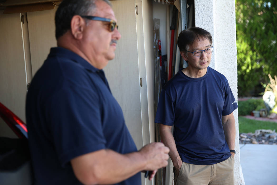 Victor Padron, left, in front of his home with his neighbor Wayne Niimi, talk about rehab cente ...