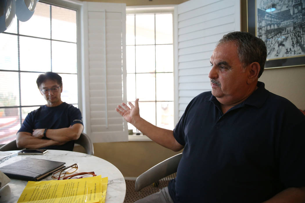 Victor Padron, right, with his neighbor Wayne Niimi, talks about a rehab center that opened nex ...