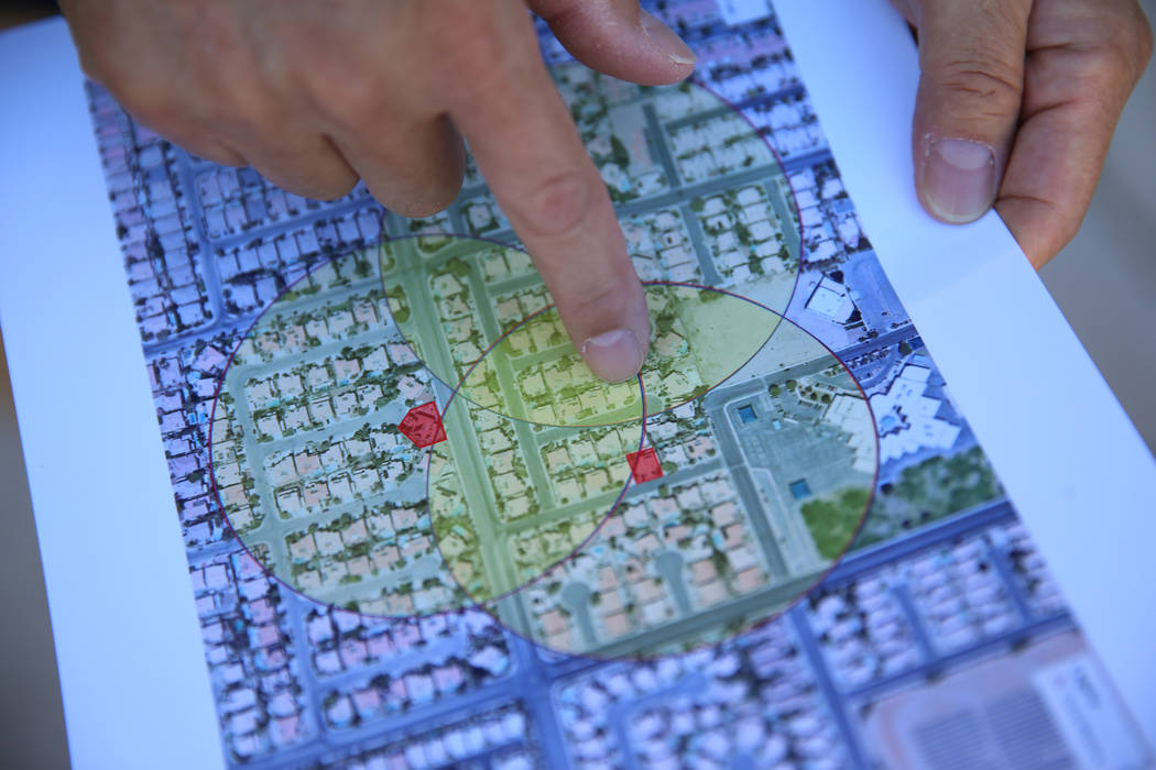 Wayne Niimi shows on a map the three residential homes in their community believed to now be re ...
