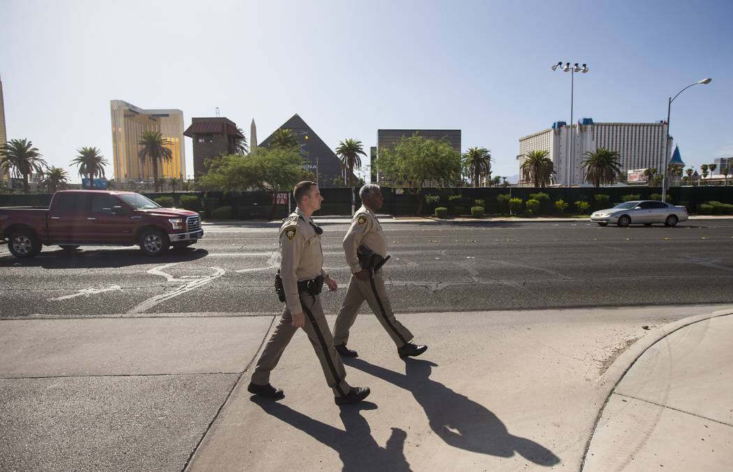 Las Vegas police officer Brandon Engstrom, left, and George Gafford, who works in the Police Em ...