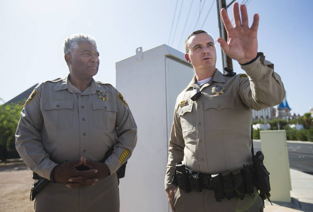 Las Vegas police officer Brandon Engstrom, right, and George Gafford, who works in the Police E ...