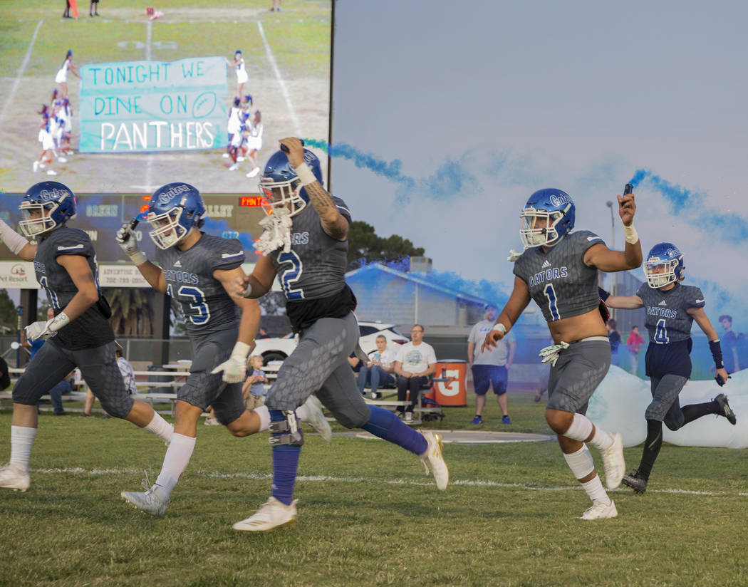 Green Valley players take the field before the start of the Gators home matchup with Palo Verde ...