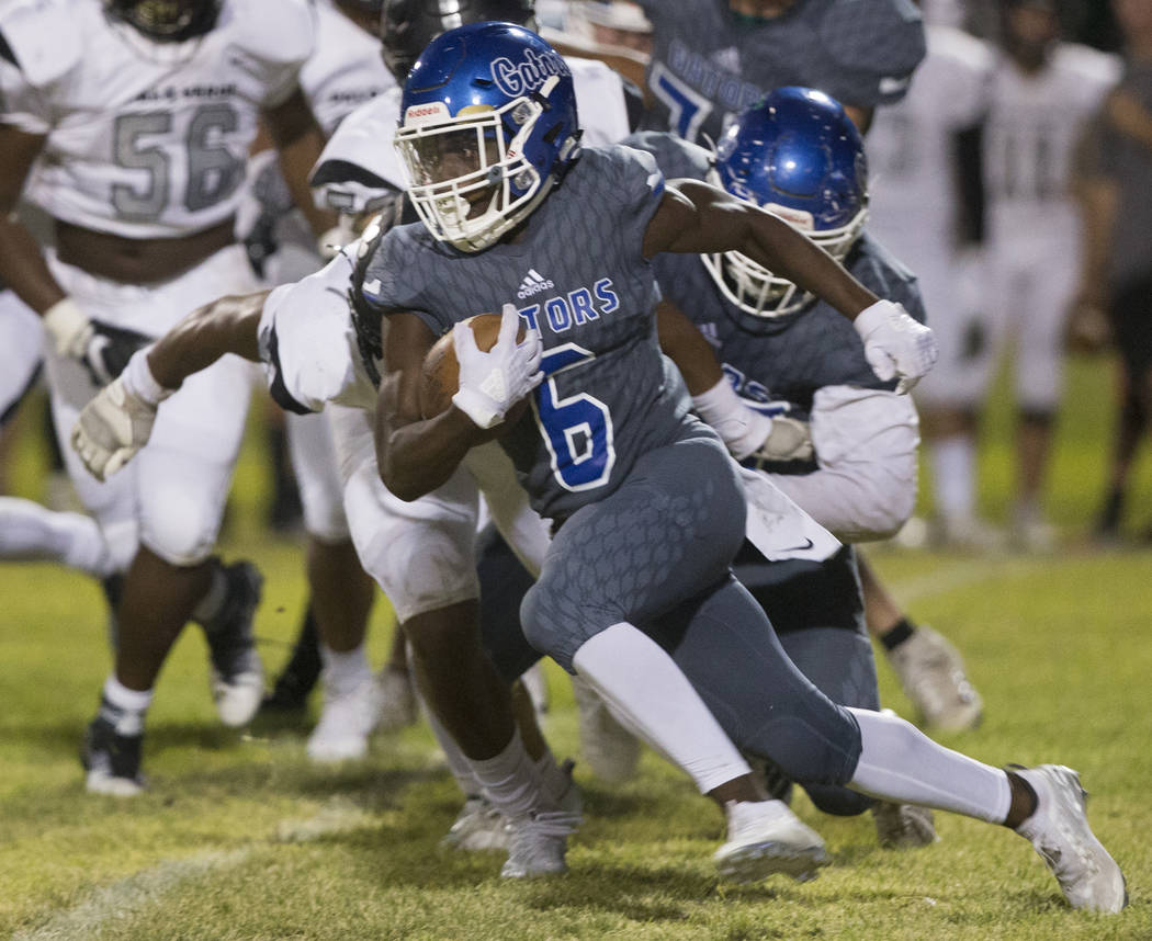 Green Valley senior running back Maaliek Duncan (6) cuts up field in the second quarter during ...