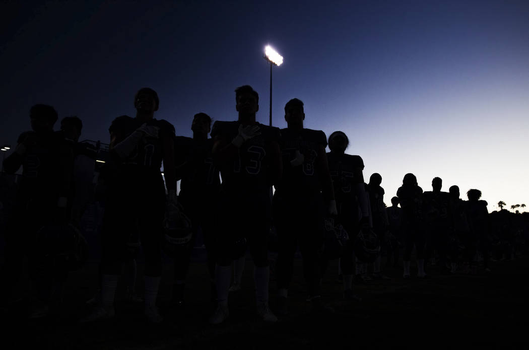 Green Valley players listen to the national anthem before the start of the Gators home matchup ...