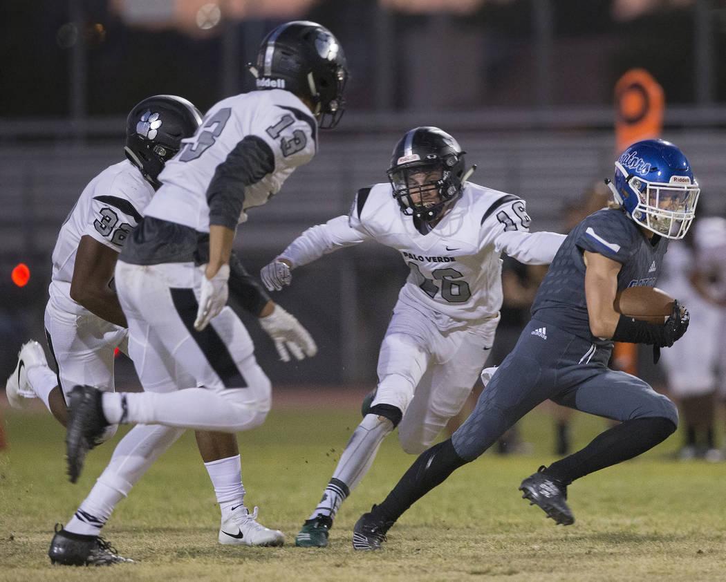 Green Valley senior wide receiver Brady Clayton (4) breaks into the open field past Palo Verde ...